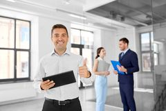 Realtor with tablet pc and customers at office Stock Photography