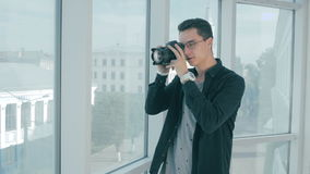 Realtor taking pictures of a real eatate and a window view. 4K stock footage