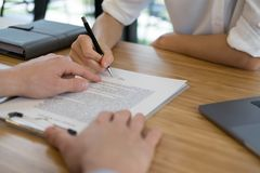 Realtor talk with client.  real estate agent have a meeting with. Customer. sale & purchase property with signing contract document. mortgage loan agreement Royalty Free Stock Photo