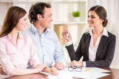 Realtor. Young couple signed financial contract with female realtor royalty free stock photography