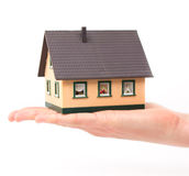 Realty concept - hand holding house. Architectural model, isolated Stock Photo