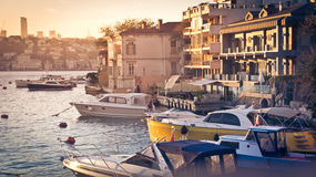 Realty. ISTANBUL, TURKEY - OCTOBER 24, 2014 : View of the boats and first raw of the waterfront houses in Istanbul, Turkey. Toned image Royalty Free Stock Photography