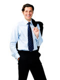 Realxed confident carefree man. Happy relieved businessman stands with his jacket over his shoulder Royalty Free Stock Photography
