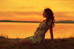 Realxed woman looking at the sunset Stock Image