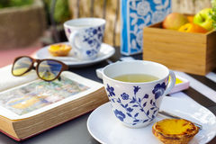 Realxing Afternoon Tea. Relaxing afternoon tea and biscuits outside Royalty Free Stock Photos
