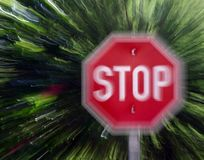 Realy stop now. Stop sign with zoom blur stock images