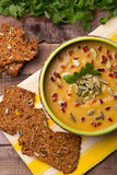 Сream soup from squash with thyme, paprika, pumpkin seeds, parsley and with rye crackers Royalty Free Stock Photo