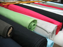 Reams of Textiles. Marketplace stall selling cloth Stock Photos