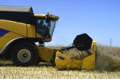 Reaping-machine threshing-machine with work Stock Images