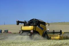 Reaping-machine threshing-machine with work Stock Photo