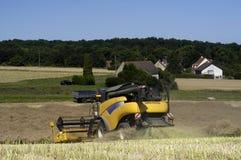 Reaping-machine threshing-machine with work Stock Photos