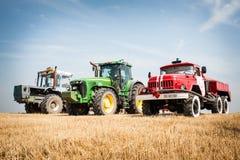 Reaping the wheat harvest. July 24, 2015. Kiev region, Ukraine. Ukrainian farmers are reaping the wheat harvest in the fields near Kiev Royalty Free Stock Image