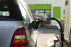 Reaprovisionamiento, gasolina, transporte, combustible, protección del medio ambiente, foto de archivo libre de regalías