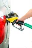 Reaprovisione la gasolina de combustible en la gas-estación Imágenes de archivo libres de regalías