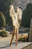 Rear of angel stone sculpture at Monumental Cemetery, Milan Royalty Free Stock Photo