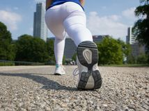 Rear angle of woman stretching outdoors Royalty Free Stock Image