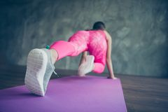 Rear back behind view of her she attractive sportive perfect lady wearing pink outfit look standing in positing ready. Leaning on hands pilates abt in modern stock photo