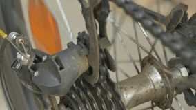 Rear Bicycle Cogset in Action. Rear bicycle cogset and roller chain working stock footage