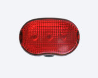 Rear Bike Lamp Isolated on White. A rear red blinking LED light for a bicycle with clipping path Royalty Free Stock Photos