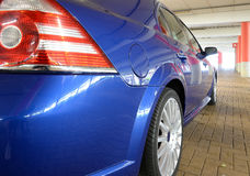 Rear of blue sports car Stock Images