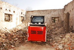 Rear of Bobcat Skid Steer Loader. A bobcat skid steer loader in a partially demolished derelict old Italian farm building Royalty Free Stock Photos