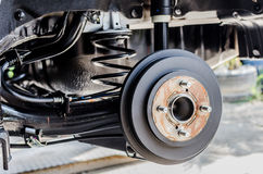 Rear  brake on car in process of new tire replacement. Stock Photo