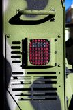 The rear brake signal of an armored military vehicle. The rear brake signal of an armored military vehicle, the protective grille and camouflage bark of the car stock photo