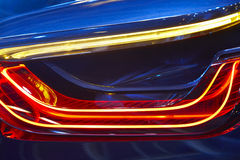 Rear car light detail in blue red tone. Vehicle part. Stock Photos