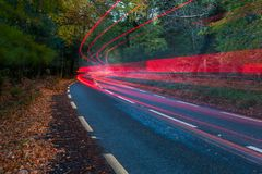 Rear Car lights zooming through autumn Stock Photos