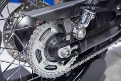 Rear chain and sprocket of motorcycle wheel.  stock photos