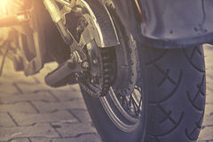 Rear chain and sprocket of motorcycle wheel. Close up on rear chain and sprocket of motorcycle wheel Royalty Free Stock Image