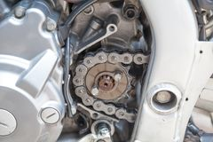 Gear wheel with chain of motorcycle wheel. Royalty Free Stock Images