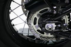Rear chain and sprocket. Of motorcycle wheel royalty free stock image