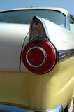 Rear Classic Car. Rear tale light of a two-tone classic car Stock Image
