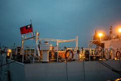 Rear of a coastguard boat with flag of Taiwan at dusk stock photography