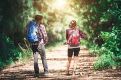 Rear of the couple hiking. Couple adventure travel. royalty free stock photo