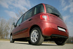 Rear end. Unusual low wide angle of italian mpv stock photos