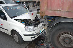 A rear-end collision. Near Milan, Italy. The car failed to stop when the articulated lorry stopped at the traffic under the rear of the lorry. There were no stock images