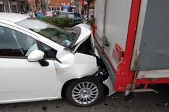 Rear-end collision. A rear-end collision in Milan urban area, Italy. The car failed to stop when the articulated lorry stopped at the traffic. The car's bonnet stock photos