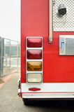 Rear end of red firetruck. On the street stock photo