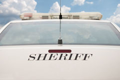 Rear end of a sheriff's patrol car Royalty Free Stock Photos