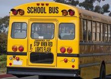 Rear end of yellow school bus Stock Photos