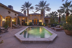 Rear entrance  of luxury villa at night with swimming pool Stock Image