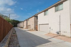 Rear entry garage of brand newly built house in Texas, USA. Typical rear entry garage of brand newly built house sold signs in Texas, USA. Row of detached lot stock photography