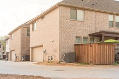 Rear entry garage of brand newly built house in Texas, USA. Typical rear entry garage of brand newly built house in Texas, USA. Row of detached lot with garage Royalty Free Stock Photography