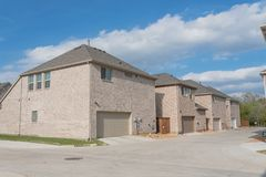 Rear entry garage of brand newly built house in Texas, USA. Typical rear entry garage of brand newly built house sold signs in Texas, USA. Row of detached lot stock images