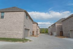 Rear entry garage of brand newly built house in Texas, USA. Typical rear entry garage of brand newly built house sold signs in Texas, USA. Row of detached lot stock photos