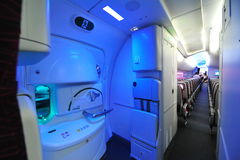 Rear exit and economy class of Qatar Airways' Boeing 787-8 Dreamliner at Singapore Airshow Stock Photography