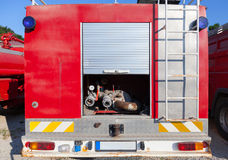 The rear of fire truck with water pump Royalty Free Stock Images