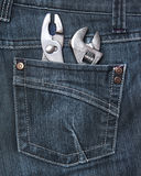 Rear jeans pocket with tools. Person wearing a jeans with tools in his rear pocket Royalty Free Stock Images